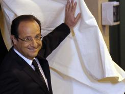 Socialist Party candidate Francois Hollande leaves the voting booth on Sunday in Tulle, central France.