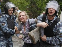 Police detain a protester in downtown Moscow shortly after Vladimir Putin's inauguration Monday.