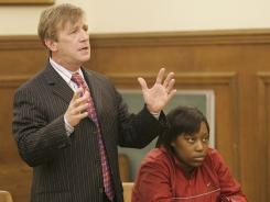 Attorney Joe Brandon Jr. makes a point during a court hearing. Shanterrica Madden, right, has been charged with first-degree murder of Tina Stewart.