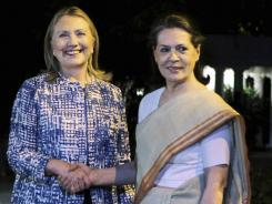 Secretary of State Hillary Rodham Clinton meets with Sonia Gandhi, president of India's Congress party, in New Delhi on Monday.