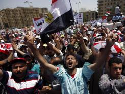 Egyptians chant slogans as they protest in Tahrir square in Cairo.
