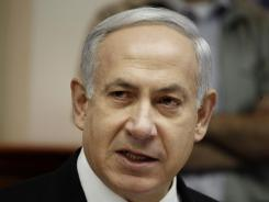Israeli Prime Minister Benjamin Netanyahu chairs the weekly cabinet meeting at his Jerusalem office today.
