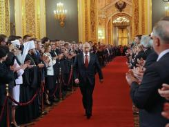 President-elect Vladimir Putin walks to his inauguration ceremony in St. Andrew's Hall of the Kremlin in Moscow on Monday.