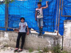 Young boys hang out outside Yayladagi refugee camp.