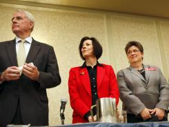 Candidates stand during adjournment of a gubernatorial candidate forum hosted by the Democratic Party of Dane County in Madison, Wis., in April.