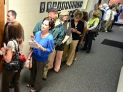 People wait in line to vote in North Carolina's primary elections at a polling station Tuesday at Mount Zion Lutheran Church in Conover, N.C.
