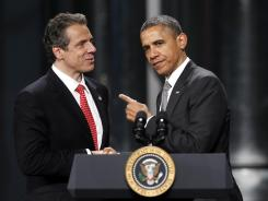 President Obama acknowledges New York Gov. Andrew Cuomo after being introduced in Albany, N.Y., on Tuesday.