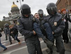 Police detain a protester during a rally against Vladimir Putin's inauguration in St. Petersburg, Russia, on Monday.