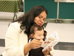 Marciela Chavez and her son Isaac participate in a meeting in Save the Children's Early Steps to School Success program in California.