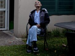 A patient sits in the garden of a hospice facility for terminally ill patients in Buenos Aires.