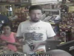 In this photo made from surveillance video, murder suspect Adam Mayes is in a convenience store April 30 in Union County, Miss.