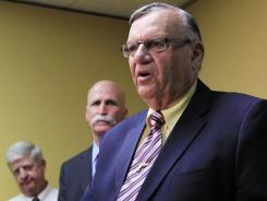 Maricopa County Sheriff Joe Arpaio, right, faces allegations of civil rights violations.