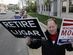 In Indianapolis, Brent Gentry shows his support last month for ousting Sen. Richard Lugar.