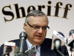 Federal authorities on Wednesday said that they plan to sue Maricopa County Sheriff Joe Arpaio, pictured, and his office over allegations of civil rights violations, including the racial profiling of Latinos.