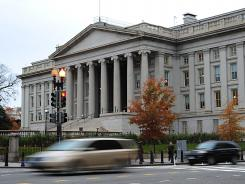 The U.S. deficit totaled $719 billion through the first seven months of the budget year, according to the Treasury Department.