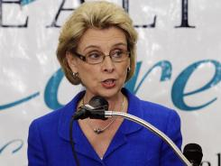 Washington Gov. Chris Gregoire announced the opening of an emergency fund to help contain a whooping cough epidemic in the state as officials urged residents to get vaccinated.