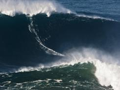 Garrett McNamara surfs a 78-foot wave at Praia do Norte beach in Nazare, Portugal, Nov. 1, 2011.
