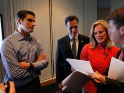 Mitt Romney, his wife, Ann Romney, and son Josh Romney review early election returns with a staffer as they wait to attend their Florida primary night party on Jan. 31 in Tampa.