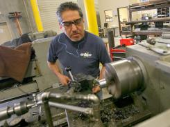 Machinist Jose Tovar works on windmill parts at Enxco's North Palm Springs, Calif., facility. Enxco owns and maintains hundreds of windmills in the Coachella Valley area.