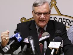 A defiant Maricopa County Sheriff Joe Arpaio, pounds his fist on the podium during a Thursday news conference as he answers questions regarding the Department of Justice announcing a federal civil lawsuit.