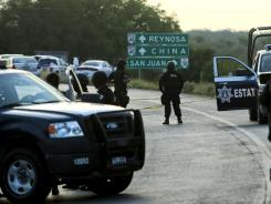 Mexican federal personnel police block the road between the cities of Monterrey and Reynosa, Mexico.