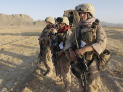 In Afghanistan: Marine Female Engagement Team members on patrol.