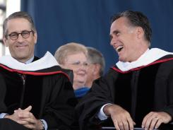 Mitt Romney shares a laugh with adviser Mark Demoss before delivering the commencement address at Arthur L. Williams Stadium on the campus of Liberty University.