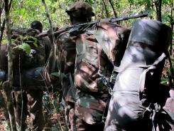 Ugandan soldiers hunting for Joseph Kony walk through the jungle near River Vovodo in April.