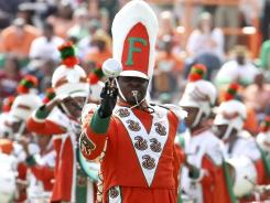 Florida A&M Marching 100 Drum Major Robert Champion performs at Bragg Memorial Stadium in Tallahassee.