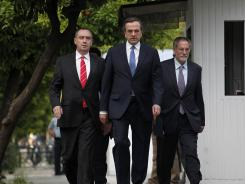 Greek conservative party leader Antonis Samaras, second left, arrives at the presidential palace for a meeting with President Karolos Papoulias in Athens on Monday.