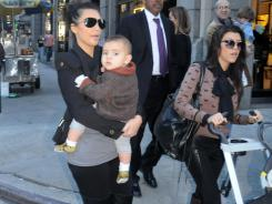 Kim Kardashian, Mason Disick and Kourtney Kardashian out for lunch at Serafina on Nov. 13, 2010 in New York City. Mason was the No. 2 baby boy name in 2011.