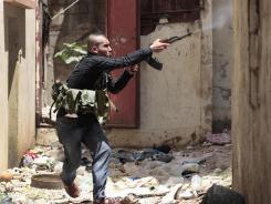 A Sunni gunman fires during clashes in Tripoli, Lebanon, on Monday.