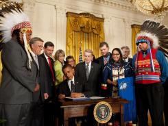 President Obama, with Native American leaders, signs the Tribal Law and Order Act in July 2010 at the White House. The law gives tribes the authority to sentence criminals for up to three years.