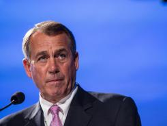 House Speaker John Boehner speaks at the Peter G. Peterson Foundation's 2012 fiscal summit in Washington on Tuesday.