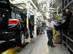 Rick Twitty installs seats into cars at a Toyota plant in Princeton, Ind., in February.