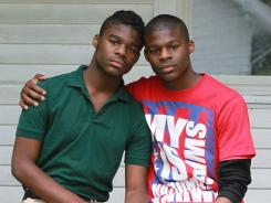 "Darnell ""Dynasty"" Young, left, a gay student at Arsenal Tech High School in Indianapolis, is on suspension and faces possible expulsion after using a Taser to scare off a group of six kids who used gay slurs and threatened to attack him on campus."