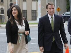 John Edwards and his daughter Cate Edwards enter the federal courthouse in Greensboro, N.C., on Tuesday.