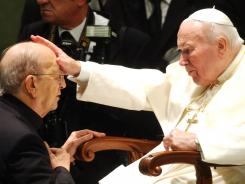 Pope John Paul II gives his blessing to late father Marcial Maciel, founder of Christ's Legionaries. The Legion has been beset by scandal following revelations that Maciel fathered three children and sexually abused his seminarians.