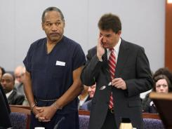 O.J. Simpson and his then-lawyer Yale Galanter appear during his sentencing hearing at the Clark County Regional Justice Center in Las Vegas.