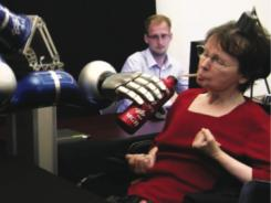 A brain implant patient uses an assistive robot to drink a cup of coffee, her first self-pour in 14 years.