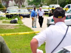Brevard County crime scene workers conduct an investigation after Tonya Thomas shot her four children, then herself Tuesday in Port St. John, Fla.