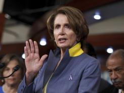 House Minority Leader Nancy Pelosi gestures during a news conference on Capitol Hill on Wednesday to discuss the Democrats' fight with Republicans over the Violence Against Women Act.