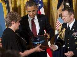 President Obama presents Rose Mary Sabo-Brown with the Medal of Honor for her late husband, U.S. Army Specialist Leslie H. Sabo, Jr.