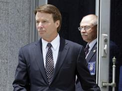 John Edwards leaves a federal courthouse in Greensboro, N.C., on Wednesday after his defense team rested.