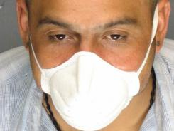 Armando Rodriguez is seen wearing a protective mask.