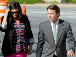 John Edwards arrives with daughter Cate Edwards at the federal courthouse in Greensboro, N.C., on Thursday.