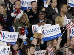 Supporters of Mitt Romney cheer at his election night party in Novi, Mich., in February.