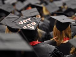 A graduating student's decorated mortarboard stands out during May 2012 commencement ceremonies.