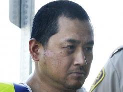Vince Li, accused of stabbing, beheading and cannibalizing another man on a Greyhound bus in Canada, is brought to a court in Portage La Prairie, Canada, on Aug. 5, 2008.