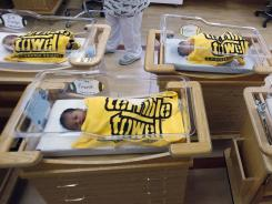 Newborns lined up last year in Pittsburgh are wrapped in Steelers towels. The Census says more than half the babies born in 2011 were members of minority groups.